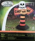 """Gemmy Halloween Skeleton with Lighted  """"Candy This Way"""" Sign Airblown Inflatable"""