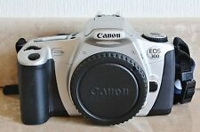 Canon EOS 300 35mm SLR Film Camera Body with Body Cap, Strap + Owners Manual.