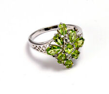 .925 Sterling Silver Ring Decorated with Peridot Size: Q
