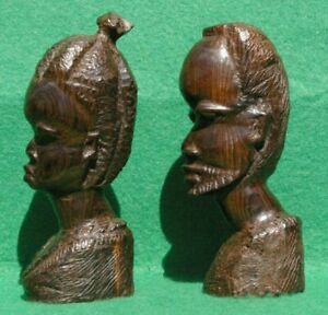 PAIR OF NATIVE MALE AND FEMALE BUSTS IN WELL CARVED DARK BROWN HARDWOOD