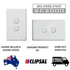 New - Clipsal Slimline Impress Push Button 2 Gang Light Switch (Blue LED)
