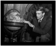 Gary Cooper Looking at Globe High Quality Photo
