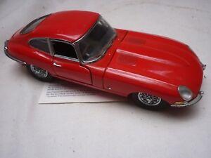 A Franklin mint scale model car of a 1961 Jaguar XKE. no box or paperwork
