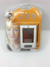 PALM ZIRE HANDHELD. BRAND NEW IN PACKAGE DATE BOOK, ADDRESS, NOTE PAD AND MORE