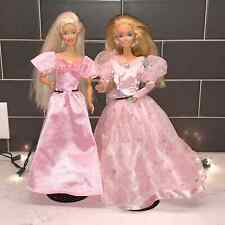 Two barbies .