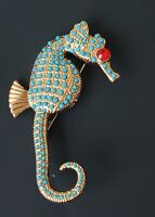 Vintage  seahorse brooch in  enamel on gold tone metal
