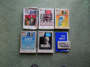 Five Commodore Vic 20 16k Vintage Game Cassettes and a cartridge + VIC-20 guide.