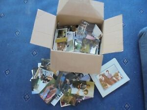box of mixed coloured photographs (s)