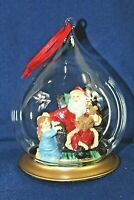 Christmas Ornament Santa Holding A Teddy Bear With Child In A Glass Bubble