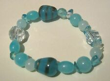 Lovely elasticated beaded bracelet with a great variety of blue beads