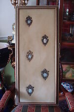 """Velvet and cameos, beautiful cameos on a beige velvet in wooden frame. 36 """""""