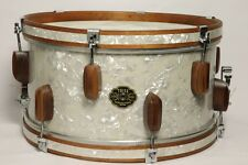 Hand made Rolling Bomber Wood snare and tom drum lugs. Lacquered walnut.