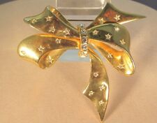 Vintage Joan Rivers Gold Bow Pin with deep set Crystal