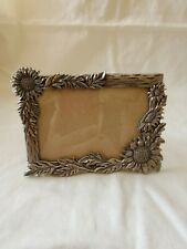 """Sunflower Metal Picture Frame Silver metal. Measures 6"""" x 4""""."""