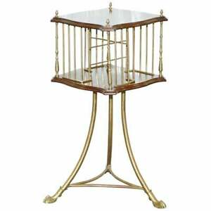 ORNATE 19TH CENTURY MAHOGANY AND BRASS REVOLVING BOOKCASE IN THE REGENCY STYLE