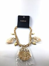 Ivory raffia shiny gold  with crystal glass stones statement necklace