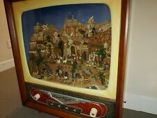 "Nativity scene with moving figures in lighted cabinet, 31""L x 12""W x 36""H"