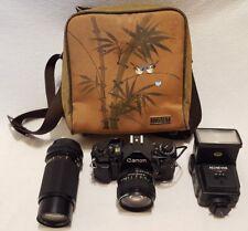 Canon A1 A-1 35mm SLR Film Camera with 50 mm lens + Achiever Flash + Britek Lens