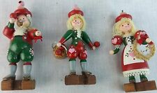 Christmas ornament red green wooden figures yarn hair blond 2 girls 1 boy