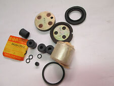 Suzuki RE5 GT250 GT380 GT550 GT500 GT750 nos caliper rebuild and pad set 73-77