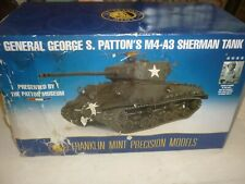 A Franklin mint of a scale model of a General George Patton M4-A3 Sherman tank