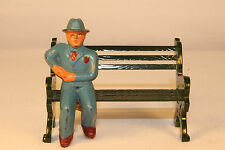 BARCLAY MANOIL MAN  SITTING ON A BENCH