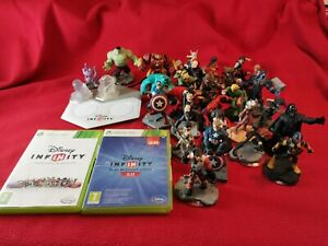 Disney infinity bundle xbox 360 2 discs, launchpad, 2 crystals and 27 figures