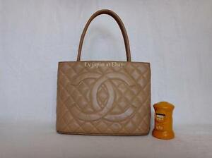 AUTH CHANEL BEIGE Quilted Caviar Leather Gold Medallion