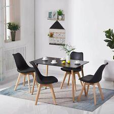 Mesa de comedor de madera negra y 4 sillas acolchadas para cocina casera