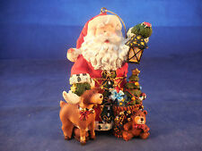 "4 1/2"" resin santa with deer and toys ornament in tin storage box"