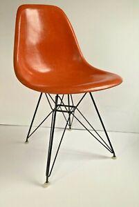 Eames orange fiberglass shell chair original Eiffel Tower base Herman Miller