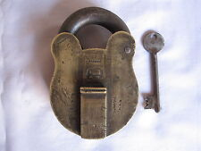An old solid brass padlock or lock with key elephant marking heavy