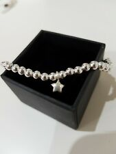 100% Sterling silver 4mm bead stretch bracelet. With sterling star charm. Boho