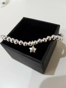 100% Sterling silver 4mm bead stretch bracelet. With sterling star charm. Boho