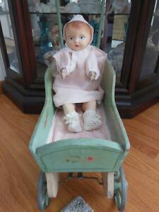 ANTIQUE VINTAGE MECHANICAL MOVING TIN BABY DOLL IN WOOD BUGGY PRAM STROLLER