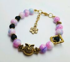 Pink and black , gold Owl  , bracelet with gold flower charm.