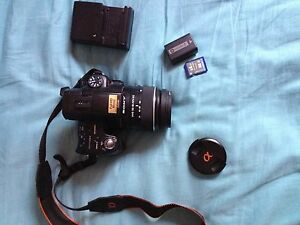 Sony 350 DSLR with memory card, lens, battery, and charger