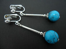 A PAIR OF  LONG DANGLY TURQUOISE BEAD CLIP ON EARRINGS. NEW.