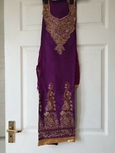 Unstitched purple and gold floral selwar kameez material