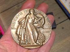 """Médaille en Bronze  """"Mérite et Fidélité""""  maisons d alimentation Signé  Baudry"""