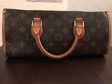 Louis Vuitton Triangle Monogram Handbag