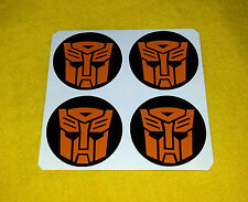 ADESIVI cerchi in lega 4 x 60mm Transformers Autobot Logo Arancione center cap Decalcomania