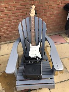 Electric Guitar Amplifier And Lead