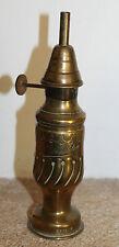 ancienne lampe a essence la madelon (deposé) ciselée dans un obus pas pigeon