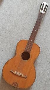 Nice, very old parlour guitar with nice inlays, needs repair!