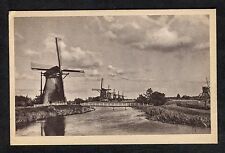 c1950s View of row of six Windmills by a Canal, Holland