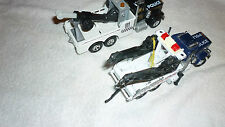 TWO POLICE TOW TRUCKS PETERBUILT & KENWORTH SUPER RIGS
