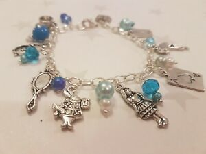 Alice In Wonderland Charm Bracelet with blue beads, drink me, white rabbit, book