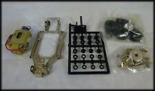 RIKO COMPETITION adjustable chassis with  Mabuchi 16D motor, new in packet.