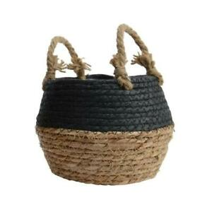 A set of 2 black and natural woven grass baskets.